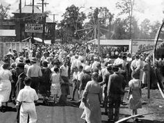 The midway during the 1932 Indiana State Fair.  Note the beanies on the boys in the foreground and the men in straw hats. Indianapolis