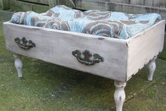 Antonia, who sells her upcycled furniture pieces at Voodoo Molly Vintage, will often acquire individual dresser drawers. Here, she made a quirky dog bed by adding four footstool legs to an oak-front drawer. See more photos of the finished piece here.