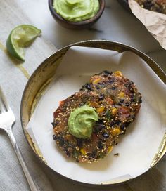 "Spicy Black Bean Cakes with Avocado Butter ~ via this blog, ""A Cozy Kitchen""."