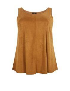 Under biker jackets, kimonos and sleeveless blazers, our Plus Size Tan Suedette Vest always looks stylish. #newlook #fashion