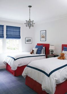 Carefully measured dashes of ocean blue and deep red punctuate this crisp bedroom. A Moravian star and variegated stripes give the usual stars and bars a tweak. The color combination is so versatile in here that the room can change from adult guest room to kiddo room with a few stuffed animals.