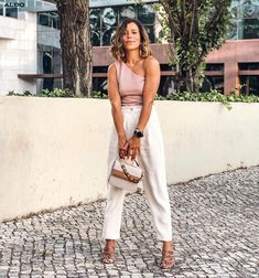 Perfectly pastel! @ineslisboncover adds a touch of colourful snake print to her look with our strappy Trelidda sandals. Shop now at aldoshoes.com.