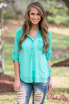 We love this lightweight blouse - it is so perfect for relaxing on the porch all summer long! The cool shade of mint is so trendy and easy to style with jeans or jeggings! It also features two buttons, a pocket, and rolled sleeves! Just add wedges to complete this look!