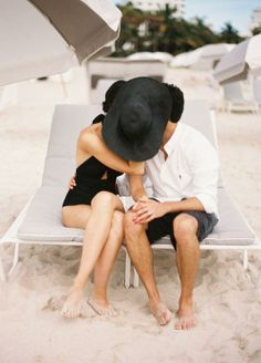 Very cute couple kissing on the beach shot