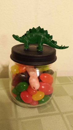 I made 20 of these cute dino jars for his party for the kids to take home! I filled them with little dinosaur eggs (jelly beans) to finish them off!