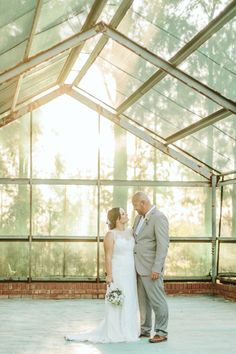 Greenhouse couple portrait | SouthBound Bride | http://www.southboundbride.com/botanical-barn-wedding-at-rosemary-hill-by-aline-photography | Credit: Aline Photography
