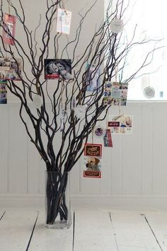 Christmas Card Tree: Hanging cards from a houseplant or tree adds a festive element to your home's decor (and all it takes is a spool of ribbon or string!). Source: Shutterfly