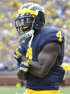 Michigan Wolverines running back De'Veon Smith is pumped up after fellow running back Ty Isaac scored on a 76-yard touchdown run in the second quarter.