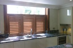 Cafe style shutters are ideal for ground level windows and town houses, Cafe style leaves the top of the window un-shuttered, using only shutters for the bottom part. Cafe Style Shutters, Kitchen Shutters, Shutter Images, Townhouse, Kitchen Ideas, Kitchen Cabinets, House Design, Homes, Windows