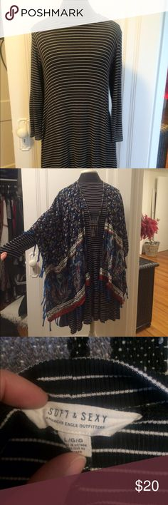 American Eagle jersey dress size large Only worn twice . American Eagle jersey black and white striped 3/4 length sleeve dress. It came to my knees and I am 5'2 . Very comfortable good quality fabric . I added a pic with it dress with an over piece to show the look. American Eagle Outfitters Dresses Midi