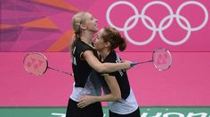 Valeria Sorokina and Nina Vislova (L) of Russia celebrate winning their women's Doubles Badminton bronze medal match against Alex Bruce and Michelle Li of Canada on Day 8 of the London 2012 Olympic Games at Wembley Arena