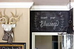 Love the high painted chalkboard wall.