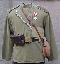 The tunic was a simple pull-over style shirt based on the traditional Russian peasant garment, worn untucked, over the trousers and belted at the waist. There were numerous variations on the basic garment, the most common being the addition of one or two patch pockets on the chest and shirt-style button cuffs. The shoulder boards were reversible, one side being khaki and the other being in the colour of the appropriate arm of service. Both sides had the unit number or cipher painted in…