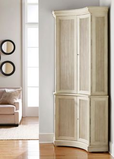 Love this unique corner cabinet
