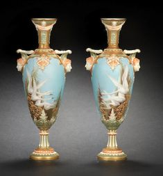 A pair of Royal Worcester vases by Charley Baldwyn, dated 1900