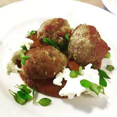 Ras el Hanout pork meatballs with chipotle chocolate sauce, goat cheese and thyme