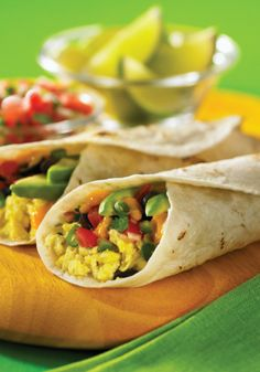 Recipe for Huevos Rancheros Wraps - Very easy. Plus, this version includes three of my favorite ingredients for Mexican dishes; whole black beans (rather than refried), sliced avocados, and fresh cilantro.