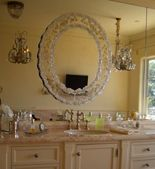 Hanging a mirror over a big mirror breaks it up. Even hanging an empty frame on top of a mirror looks great.