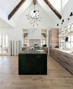 Design Trend Black Kitchen CountertopsBECKI OWENS can we make our kit cabs look like this wood color? Black Kitchen Countertops, New Kitchen Cabinets, Old Kitchen, Kitchen Black, Kitchen Sinks, Kitchen Benchtops, Laminate Countertops, Kitchen Tables, Kitchen Flooring