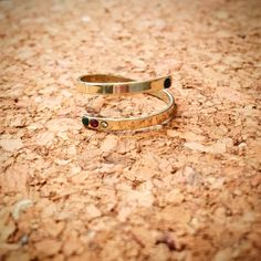 Gold ring with emerald, sapphire, ruby and brilliant