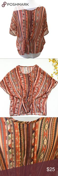 Gypsy Junkies M/L Sheer Southwest Print Poncho Gypsy Junkies sheer southwest print poncho. Great fall colors. Gathered at waist in the front to provide some shape. Pleat detail down the front. There are a few small runs in the fabric on the shoulders (see last picture), otherwise very good condition. Gypsie Junkies Tops