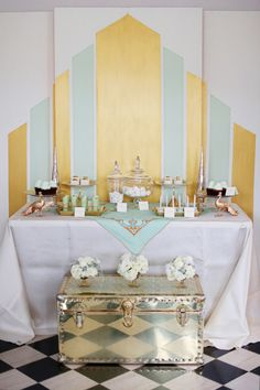 What a fun mint + gold art deco dessert table! Have your Great Gatsby and your Tiffany, too :-)