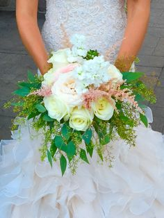 Bridal bouquet with garden roses astilbe and seeded eucalyptus