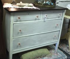 Lovely old chest of drawers now available at The Shabby Chicas' booth located at Homestead Handcrafts. Painted with chalk paint an enhanced with Artisan Enhancements' Pearl Plaster on the drawer fronts. Love the pink glass knobs!