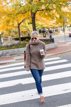 Fashion Blogger, Ashley Pletcher pairs cozy Abercrombie sweater with jeans and boots for a simple fall look.