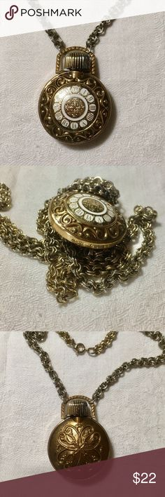 """Vintage Avon Perfume Bottle Necklace Vintage Avon perfume bottle pendant necklace is gold toned with a faux watch face on the front and a detailed design on the back. The pendant measures 2""""H x 1 1/2""""W. It doesn't have perfume in it. A little wear on the cap. Signed Avon. Jewelry Necklaces"""