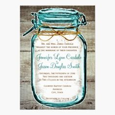 Mason Jar Barn Wood Rustic Country Wedding Invitation Cards. Beautiful wedding invitations featuring a teal turquoise aqua blue tinted mason jar with a twine bow design on top of a distressed barn wood background.
