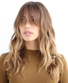 Light Brown Layered Hairstyle With Bangs. This soft brown ombre boasts shaggy layers throughout and extra long light bangs that you may want to pin up or to the side when doing any sort of activity.