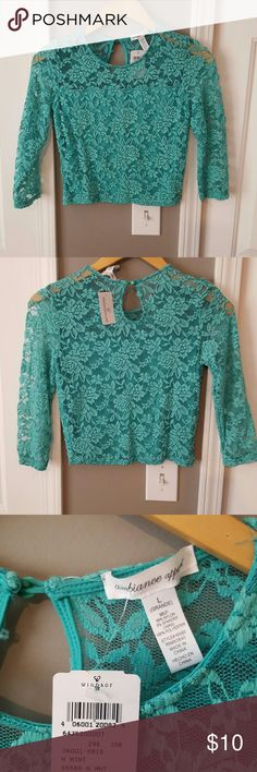 Crop top Teal lace crop top. 3/4 sleeve. Never worn. Sheer lace on sleeves and shoulders. Ambiance Apparel Tops Crop Tops