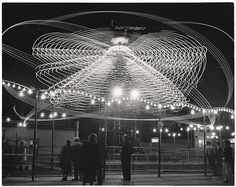 Andreas Feininger, The Hurricane, Coney Island, New York, 1949 // Long exposure shots of fairground rides in Coney Island