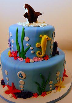 orca jumping out of top of cake with clean ocean decorations, 2 tiers