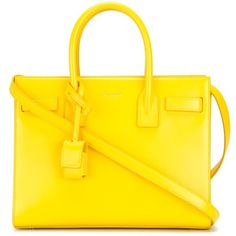 Yellow  calf leather baby 'Sac de Jour' tote from Saint Laurent featuring round top handles, a front center logo stamp, a padlock fastening detail, a detachabl…