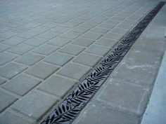 Made in the USA - Iron Age Designs grates for driveway/walkway rain runoff. This system can be used to direct water to an under ground cistern.