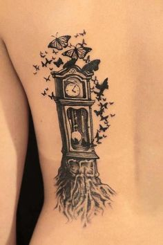 Clock...tree...butterfly tattoo!!! I might switch the butterflies for birds though. Awesome!