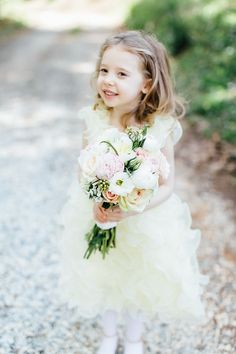 Such a cute little flower girl! Photo by Mary Stafford Photography.