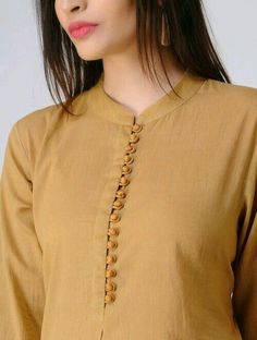Olive Pleated Cotton Mul Kurta with Potli Buttons Olive Pleated Cotton Mul Kurta with Potli Buttons Chudidhar Neck Designs, Neck Designs For Suits, Sleeves Designs For Dresses, Neckline Designs, Dress Neck Designs, Sleeve Designs, Kurtha Designs, Blouse Designs, Salwar Designs