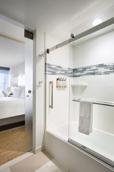 Now showing photo 7, Guest Bathroom with Glass-Enclosed Tub