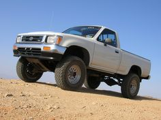 1994 Toyota Pickup looks alot like my '92 but no stickers, fog lights and minus a dent.