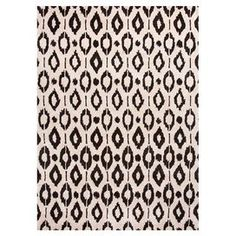 """Lend a pop of pattern to your living room or master suite with this striking hand-tufted rug, showcasing an exotic trellis motif in cloud white.  Product: RugConstruction Material: 70% Wool and 30% art silkColor: Cloud white and deep charcoalFeatures:  Hand-tuftedDurablePlush pile Made in IndiaPile Height: 0.5""""Note: Please be aware that actual colors may vary from those shown on your screen. Accent rugs may also not show the entire pattern that the corresponding area rugs have."""