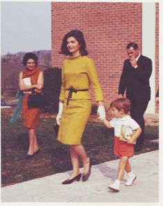 Jackie Kennedy leaving church with John Jr in Middleburg, VA October 1963. UPI reporter Helen Thomas is at the left.  ❤❤❤❤❤❤❤ http://en.wikipedia.org/wiki/Jacqueline_Kennedy_Onassis   http://en.wikipedia.org/wiki/John_F._Kennedy,_Jr.