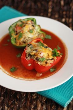 Mexican Stuffed Peppers with Quinoa & enchilada sauce