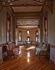 A hall and room of Amsterdam Castle, Amsterdam, NY.  The room dividers are more elaborate than any I've seen.  I wonder what the significance of the lettering/numbering is.  Love the pendant light in the round room and the diagonal hardwood floor.