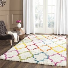A classic quatrefoil motif pairs with multicolor hues to round out the eye-catching Kids Ivory Shag Area Rug, a distinctive addition to your decor. Use it to anchor your little one's room in traditional style then pair it with a charming floor lamp for a dynamic look. Round out the arrangement with framed prints for an artful display. The rug's understated design makes it blend effortlessly into any ensemble, from beachy coastal-chic to crisp contemporary. Use it to level out handsome...