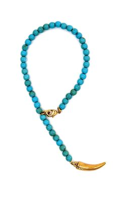 Italian horn charm on turquoise prayer bead bracelet