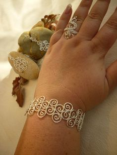 Spiral ring wire jewelry. $20.00, via Etsy.