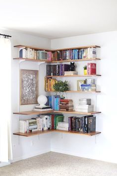 DIY Wall-Mounted Shelving Systems Easy to Install One of my favorite small space hacks is swapping your bookcases for wall-mounted shelving. We've created roundups of wall mounted shelving systems before, but for those of you who are especially crafty t Design Ikea, Diy Design, Design Trends, Design Desk, Library Design, Wall Mounted Shelves, Wood Shelf, Diy Wall Shelves, Shelves For Walls